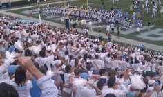 """October 6, 2012: """"Players celebrate a 48-34 victory over Virginia Tech with the Tar Pit."""""""
