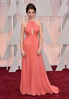 """Anna Kendrick in a lovely gown at the Oscars. They describe it as an """"unexpected sunset hue"""" - which gives me great ideas!"""