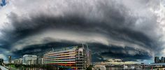 A storm passes over Docklands, Melbourne, Australia. Photo by Robyn Lakeman. Cloud Appreciation Society.
