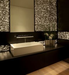 Glamorous wall treatment gives this gorgeous bathroom a glittering nightclub effect.
