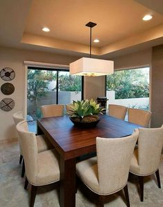 Another space-saving alternative is to buy rounded table. They can provide versatile sitting as it does not have restricting corners. Dinner Room, Dining Lighting, Dining Room Inspiration, Dining Room Design, Living Room Decor, House Design, House Styles, Home Decor, Sweet