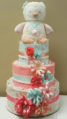 Coral and robin egg blue! Owl Baby Girl Diaper cake! Baby shower!  I love the ribbon flowers! Check out my Facebook page, Simply Showers  https://m.facebook.com/adorablegifts