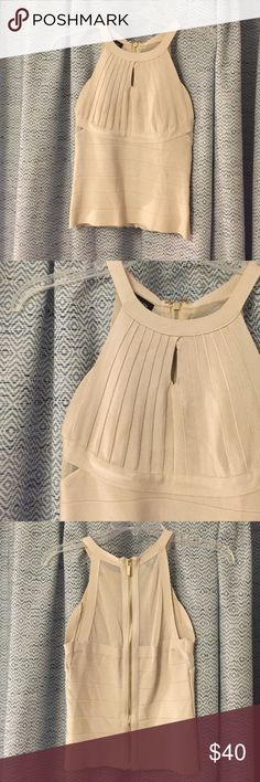 Bebe Sandshell Bandage High Neck Shirt Amazing shirt ! Too small for me only reason I'm selling. Size medium but selling as a small because it runs tight! Keyhole cutout, looks great with maxi skirt. No low balls! bebe Tops Tank Tops
