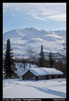 Snowy cabin and mountains. Wiseman, Alaska, USA