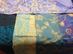 Screenprinted silk wraps with traditional designs from ArnhemLand