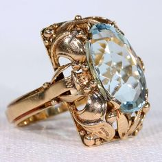 Retro Era Aquamarine Gold Ring   From a unique collection of vintage cocktail rings at https://www.1stdibs.com/jewelry/rings/cocktail-rings/