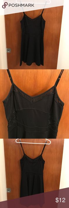 Express Black flared dress Form fitting at top, sex flare at bottom portion. Adjustable straps, cute lace detailing. Nice, thicker cotton material. Worn once, in excellent condition. Express Dresses