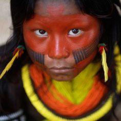 "An indigenous child from Kayapo tribe attends first indigenous assembly for the ""Rio Conference at Kari-Oca village in Rio de Janeiro, June REUTERS/Ricardo Moraes"