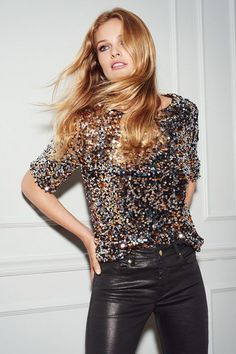 Sequined blouse & leather pants.