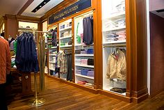 Polo store utilizing hardwood and brass fixtures to give a rich, masculine ambiance.
