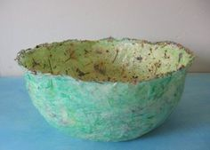 Paper mache bowl made from tissue paper and dried flowers. From Molly Chicken.