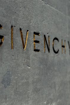 Givenchy engraved signage in gold