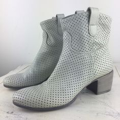 """[Principe de Bologna] Gray Leather Booties 36/6 Buttery soft pair of designer Italian leather boots. Pull on style. Slight slouchy. Perforated design. Wood heels have a white wash finish.  Color: Very Light Gray Material: Leather  Size: 36 (6) Shaft Height: 6"""" Heel Height: 2"""" Condition: EUC. Only signs of wear is scuffing on soles. Heels in excellent shape. This leather and quality will last for years!  No Trades! No PayPal! Principe de Bologna Shoes Ankle Boots & Booties"""
