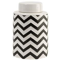 Lidded ceramic canister with a chevron motif.   Product: Lidded canisterConstruction Material: CeramicCo...