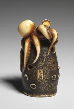 Netsuke. Octopus and pot. Made of ivory, with eyes inlaid in dark horn. Ohara Mitsuhiro 大原光廣 Edo Period. 19th century. British Museum.