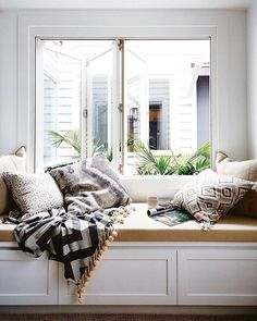 We wish it was still the weekend and we were curled up in a cosy corner like this one in @darrenanddeanne home.... with a suite of @waltergtextiles cushions! . Image via @insideoutmag . #waltergtextiles #blockprinted #celebritypillows #interiordesign #inspiration #dreamhome #baywindow #neutrals #layering