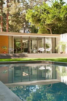 This Mid Century Renovation in verdant canyon close to the ocean in Los Angeles is perfect, almost perfect. I love that the house is essentially