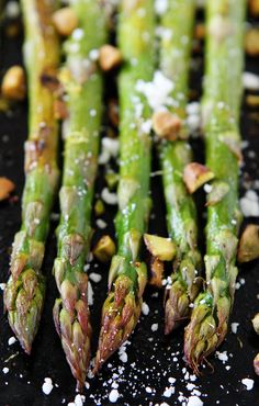 Roasted Asparagus with Lemon, Feta, and Pistachios Recipe on twopeasandtheirpod.com This easy oven-roasted asparagus with lemon, feta cheese, and pistachios is a MUST make for spring!