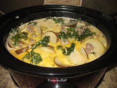 Zuppa Toscana Soup (Olive Garden Knockoff)    3 cans chicken broth  2 cups whipping cream  red pepper flakes (to taste)  salt and pepper (to taste)  1-2 cups chopped kale  3-4 potatoes sliced thin  1 lb mild Italian sausage    Place all ingredients inside slow cooker/crock pot. Cook on high 3-4 hours.  Serve with crackers or breadsticks. - From http://pinterest.com/pin/24840235416330312/
