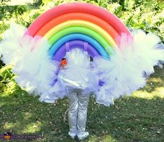 Kelly: Daughter, Emma. 5 years old. Emma wanted a rainbow, complete with raindrops & a sun! Completely homemade! I used pool noodles, 50 yards of tulle, 100 zip ties, and LOTS...