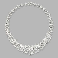 DIAMOND NECKLACE-BRACELET COMBINATION. Marquise-shaped, round and pear-shaped diamonds weighing a total of approximately 90.00 carats, mounted in platinum, length 16½ inches, necklace detaches to become two bracelets or detach two extentions to shorten length of necklace to 14 inches, length of bracelets 7 inches.