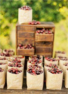 Wedding favor: fresh cherries in hand-lettered paper bags