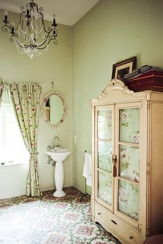 "The word ""Quaint"" comes to mind...and I LOVE quaint! Floral Floor, Chandelier,& Armoire"