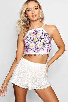 Click here to find out about the Lucy Embroidered Coin Trim Crop from Boohoo, part of our latest Tops collection ready to shop online today!