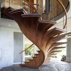 sondermill:  Oh glorious staircase. African mahogany and teak do wonders together   #liveoriginally (at SONDERMILL.COM)