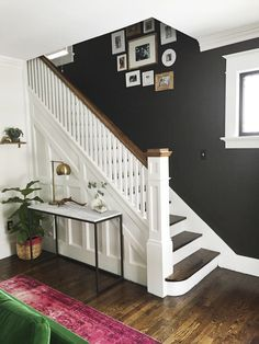 Dark wood floors can be incredibly chic and sophisticated, bringing richness and polish to a space. But when paired with the wrong furnishings and colors, those floors run the risk of making the space feel dark and heavy.  #DarkWoodFloors #DarkWoodFlooring #DarkWoodFloor #DarkWoodFloorsLivingRoom #LivingRoomDarkWoodFloors