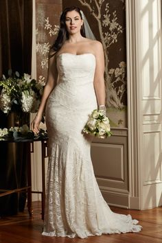 I don't even totally love this gown, but I'm just so happy to see a really curvy bride who isn't all trussed up and girded, that I had to post this.  Wtoo Brides Pippin Gown
