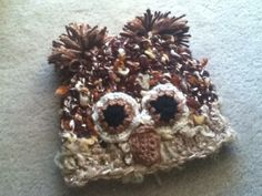 I just made this for our baby on the way.  No pattern...just scraps.  It turned out soooo cute!!   Crochet Baby Owl Hat