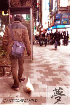 A weird man walking with a duck