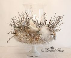 Christmas Silver & White Centerpiece with Candle. at The Decorated House blog.  Inspired by Anthropologie Mystic Nest tree topper 2009.