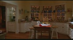 Wide shot of kitchen set in Just Like Heaven apartment. Shelves in front of windows and bar area is brilliant