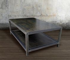 Welded Steel Two Tiered Table • Welded Steel • 1.5 tube steel frame w/ wax rub finish • Inquire for custom sizes  At J.W. Atlas we set out to create a highly functional coffee table centrally focused on a open design matched with a modern and refined industrial feel. The bold look of welded steel accentuates any room with a custom steel frame to feature clean and modern lines. This table is finished with a beautiful wax rub and offers generous open storage space underneath.  All our work is…