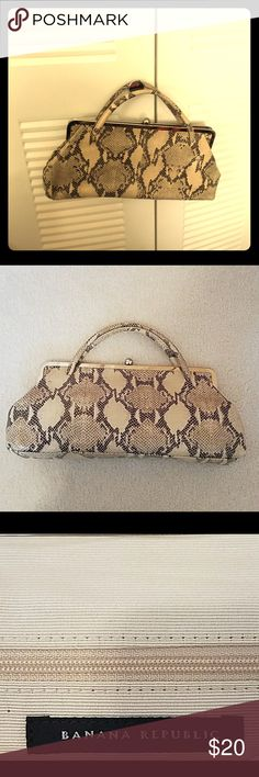 Classy snakeskin purse Beautiful classy faux snakeskin bag. EUC. Smoke free. Cat in home but no access to item. Banana Republic Bags