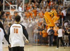 Oklahoma State's Jeffrey Carroll wears a jersey honoring the 10 members OSU's basketball team and traveling party that were killed in a plane crash 16 years ago as he warms up before an NCAA college basketball game between Oklahoma State University (OSU) and Arkansas at Gallagher-Iba Arena in Stillwater, Okla., Saturday, Jan. 28, 2017. Photo by Bryan Terry, The Oklahoman