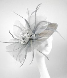 Grey Fascinator Kentucky Derby or Wedding Hat by Hatsbycressida Wedding Hats, Headpiece Wedding, Grey Fascinator, Coque Feathers, Run For The Roses, Derby Dress, Crazy Hats, Tea Party Hats, Kentucky Derby Hats