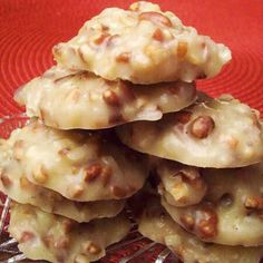 Pecan praline cookies2½cups sugar ½cup evaporated milk ½cup corn syrup ½cup butter 1teaspoon vanilla 2-2½cups chopped pecans 2½cups grated coconut 1. Set pecans, cocnut, and vanilla off to the side 2. Mix sugar, evap. milk, corn syrup, and butter in large saucepan. 3. Bring to a rolling boil & boil for 3 minutes. 4. Remove from heat & add pecans, coconut, and vanilla 5. Stir for about 4 minutes. 6. Take a spoonful of batter and place on wax paper. Let it sit until batter has hardened.
