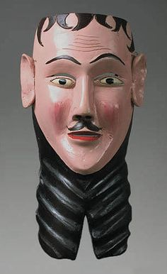 Viejo mask  Michoacan    12.5 inches, painted wood    This is a new mask intended for the Danza de Pastorelas. Especially creative hairdo and beard trim.