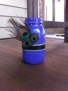 Purple Painted Mason Jar with Ribbon and Peacock Feathers