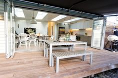 Open plan kitchen, dining and outdoors l Island bench with wood top l Reno Rumble Week 5 Full House Reveal l Photos