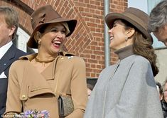 Sharing a joke: Mary and Maxima share a joke as they arrive at the Samsø efferskole...