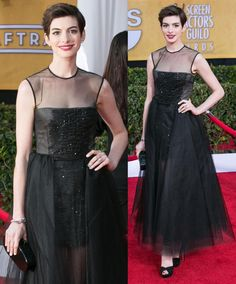 Anne Hathaway wore a black sleeveless Giambattista Valli ballerina-length gown (from the Spring 2013 Haute Couture collection) during the February 2013 Screen Actors Guild Awards held at the Shrine Auditorium in Los Angeles.