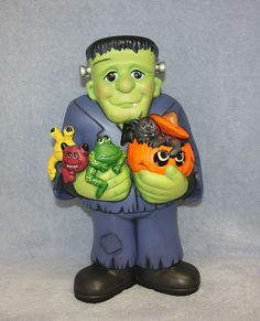 Handpainted Ceramic Frankenstein holding by FlutterbyConnections