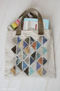 This photo transfer tote bag upgrade tutorial shows you how to make a modern triangle design on a fabric canvas tote bag. Use gel medium to transfer images.