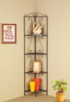"""Dark Gray Corner Shelf by Coaster by Coaster Home Furnishings. $104.00. Some assembly may be required. Please see product details.. Coaster Dark Gray Corner Shelf 910034. The Dark Gray Corner Shelf by Coaster. Features: Durable construction. Stylish and practical furniture design. Dark grey. Dimensions: 70 1/2""""H x 15""""W x 19 1/2""""L Some assembly may be required."""