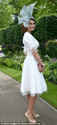 Dramatic: A beautifully dressed lady combines an elegant full skirted dress with a sculptu...