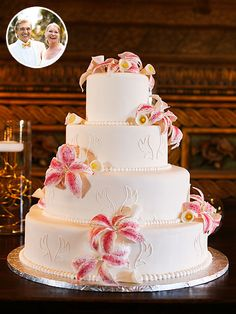 all-white wedding cake hanging on the wall of Couture Cakes bakery in Delray Beach, Florida, white fondant, the dessert featured white-cake layers, whipped cream filling, edible pearls and handmade gum-paste lilies and calla lilies. It was as simple and ...